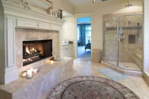 extravagant bathroom with fireplace, glass shower and whirlpool